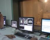 卫生创新在路上——专访东部战区总医院医学影像科主任卢光明(中)